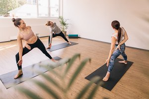 Three people practising yoga