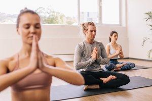 People meditating in yoga class