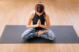 Woman in ardha padmasana yoga