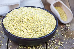 Organic millet groats in a ceramic bowl, concept for healthy eating
