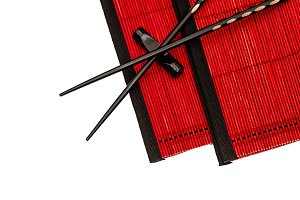Chinese chopsticks on red bamboo mat