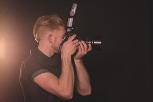 Photographer photographing in studio