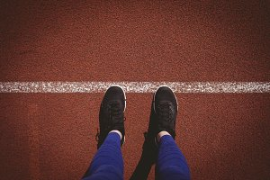 Low section of athlete on running track