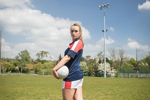 Portrait of female soccer player standing on field