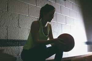Female player holding basketball