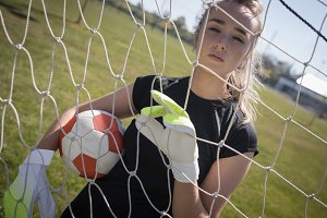Portrait of woman holding soccer ball