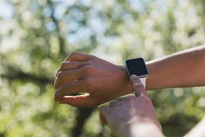Woman using smartwatch in park
