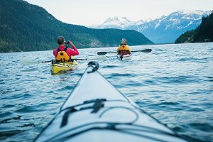 Cropped image of kayak against mature couple kayaking in lake