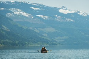 Mid distance view of couple kissing while kayaking in lake