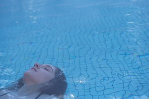 Woman relaxing in the swimming pool