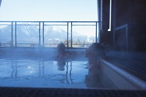 Couple relaxing together in hot tub