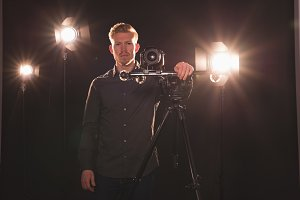 Portrait of male photographer by camera