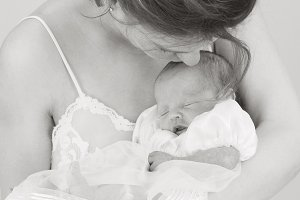 """Mother with Newborn in White"""