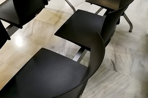 Black chairs in waiting room