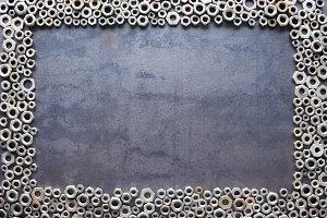 nuts frame on metal