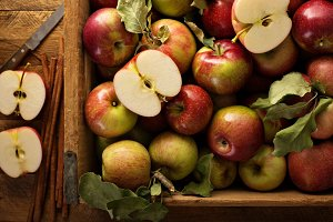 Freshly picked apples in a wooden crate