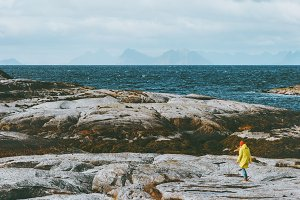 Traveler walking alone at Norway sea