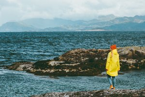Woman walking alone at  Norway sea