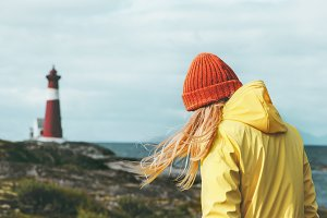 Girl walking at Norway lighthouse