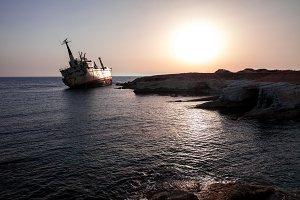 Sinking ship wreck at sunset