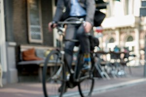Businessman with a bicycle