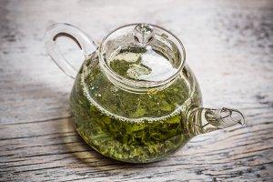 Green tea in glass teapot