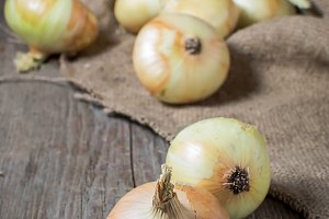 Onions on a wooden background
