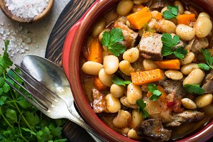 Beef stew with beans and vegetables.