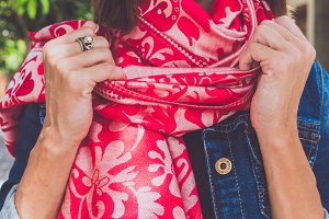 Yong woman hands with cashmere scarf. Bali island.