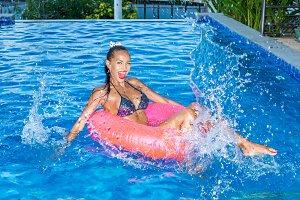 Beautiful woman have fun near pool.