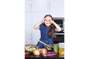 little cute girl indulges in kitchen, Family concept