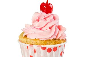 Cupcake with pink cream and cherry