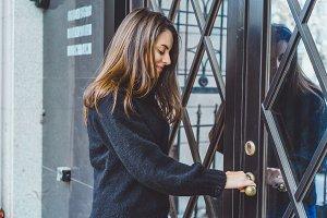 girl opens the door