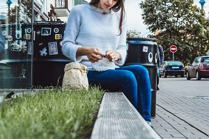 knitting in a city cafe
