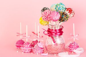 Cake pops on pink background