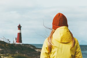 Woman enjoying Norway lighthouse