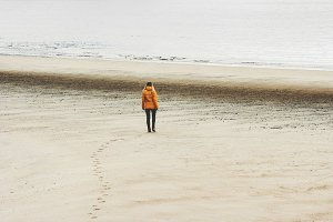 Traveler walking alone at beach