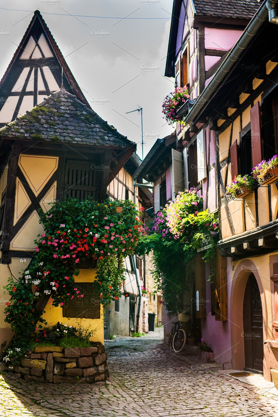 Traditional French Houses And Shops In Eguisheim Alsace France