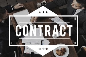 businessmen working on contract