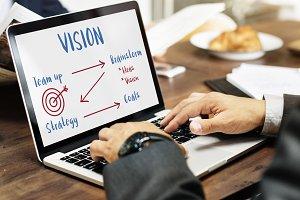 Businessman working on laptop vision