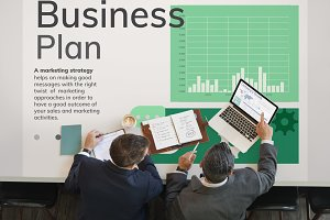 businessmen working on business plan