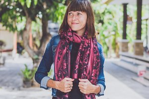 Fashionable young woman with cashmere scarf stand outdoor. Bali island.