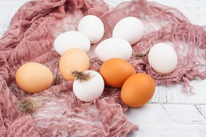 Farm producst, raw hen eggs on white wooden table