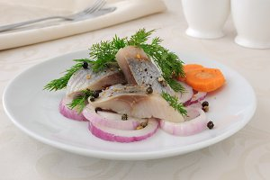 Slices of salted herring with onions