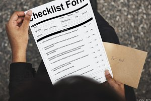 Person holding checklist form