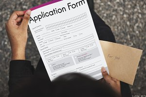 Person holding application form