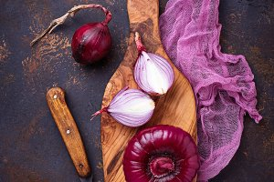 Red onion on old rusty background.
