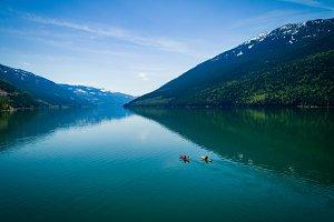 Aerial view of couple kayaking in lake