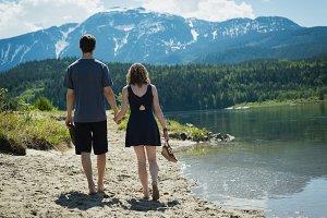 Couple walking near a lake