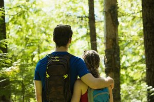 Couple standing in the forest